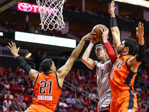 The Houston Rockets' Sam Dekker (7) is fouled by the