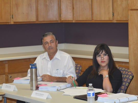 Tulare hospital board members Xavier Avila, left, and