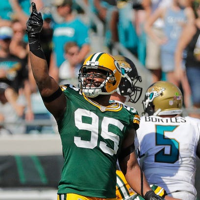 Packers defensive end Datone Jones celebrates after