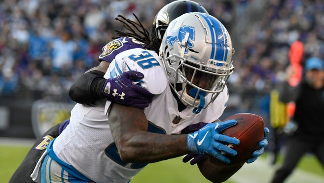 Detroit Lions running back Tion Green dives towards the pylon  for a touchdown as Baltimore Ravens cornerback Maurice Canady defends during the third quarter at M&T Bank Stadium.