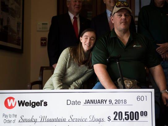 Olivia Belcher leans on her father, veteran Daniel
