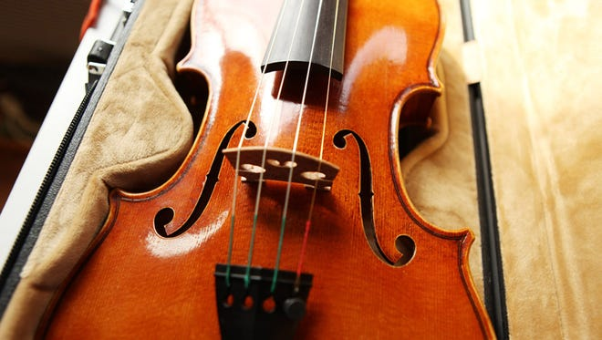Damon Gray won silver medal for violin tone at the 2014 Violin Society of America's International violin making competition in Indianapolis.  He competed with this Stradivari model violin made in his studio this year.