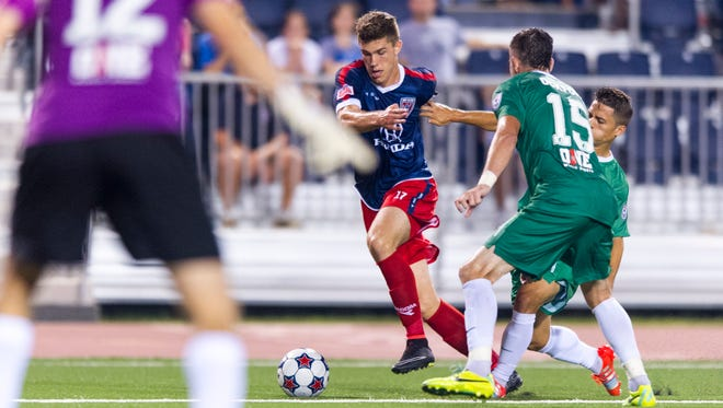 Indy Elevenâ??s Ben Spencer (17) drives the ball toward the New York goal during the second half of action. Indy Eleven hosted New York Cosmos in NASL soccer action at Michael A. Carroll Track & Soccer Stadium in Indianapolis, Saturday, August 30, 2014. The game ended in a 2-2 tie.