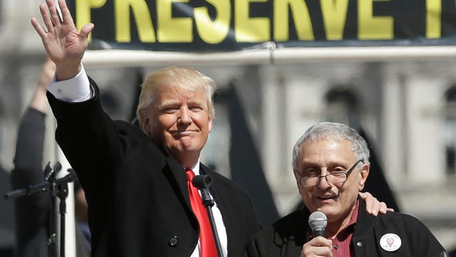 Donald Trump, left, and Carl Paladino, who ran for governor of New York as a Republican in 2010, speak during a gun rights rally at the Empire State Plaza on Tuesday.