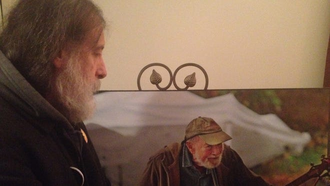 Ken Gale of New York City admires an image of Pete Seeger that was on display at a memorial held for the late folksinger in Beacon, N.Y., on Sunday, Feb. 2, 2014.