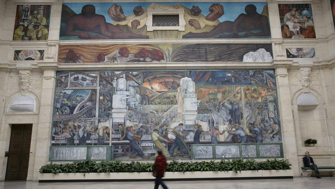 The investor group deal would require the city to pledge the Detroit Institute of Arts and its collection as collateral to secure the loan — a process that would require a legal battle over rights to the city-owned museum's prized collection. Above, a Diego Rivera mural.
