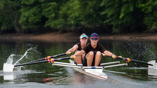 Sisters Tara Carr (left) and Rose Carr row on the Christina River this week. Both will compete at the USRowing Youth National Championships.