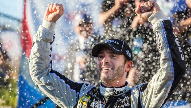 Jimmie Johnson celebrates for a second time after winning the AAA 400 at Dover International Speedway on Sunday afternoon, September 29, 2013.