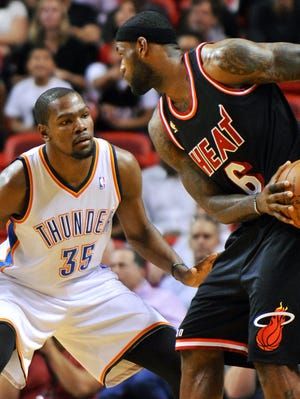 Thunder forward Kevin Durant, left, has improved on defense in recent seasons as he tries to catch up with Heat MVP LeBron James.