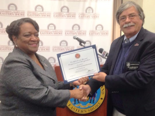UMES President Juliette Bell receives a Congressional Certificate of Recognition from Bill Reddish, a community liaison for Congressman Andy Harris, R-Md. The certificate recognizes UMES' vision to secure a USDA grant to aid small farmers in socially disadvantaged areas of the Lower Shore.