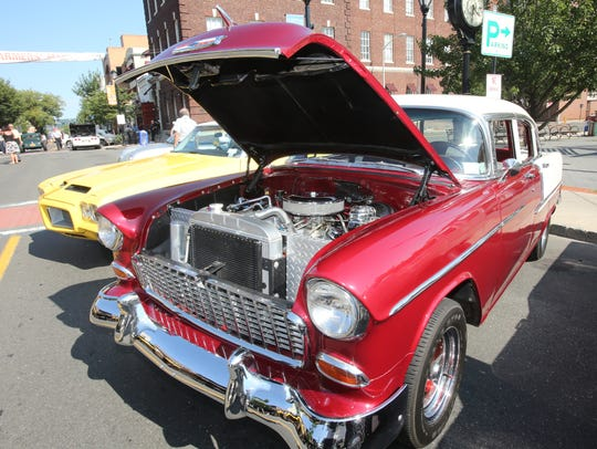 Classic cars are parked along Main Street in Nyack