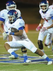 Cooper running back Tyrees Whitfield dashes up field