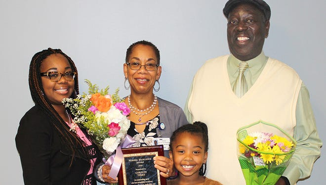 Daughter Tressha Terry-Brown, from left, Carolyn Terry, granddaughter Janaya Brown and husband Charles Terry.
