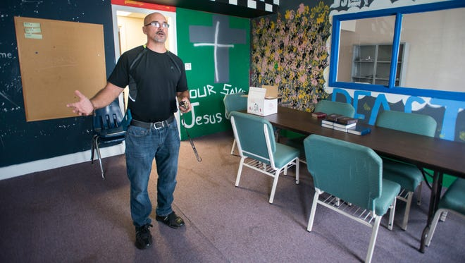 """Pastor Jeff Henry gives a tour of a room that is being renovated into a common space for the """"A Future and A Hope"""" program that is being developed at the Ensley First Baptist Church in Pensacola on Thursday, July 5, 2018."""