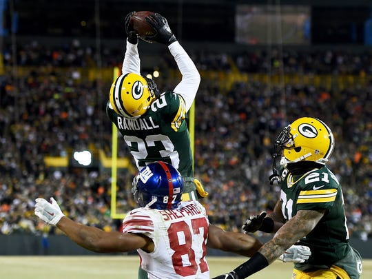 GREEN BAY, WI - JANUARY 8:  Damarious Randall #23 of the Green Bay Packers makes an interception in the fourth quarter during the NFC Wild Card game against the New York Giants at Lambeau Field on January 8, 2017 in Green Bay, Wisconsin. (Photo by Stacy Revere/Getty Images)