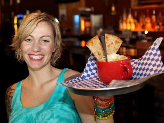 Nicki Daniels holds Cheese Motor-head Mac and Cheese at Mainstay Rock Bar.