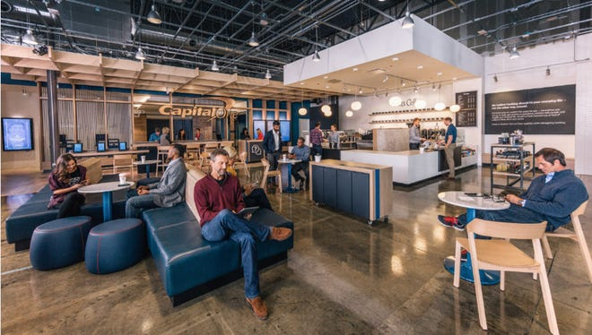 BANK CAFES: Visitors enjoy refreshments and free Wi-Fi at a Capital One Cafe.