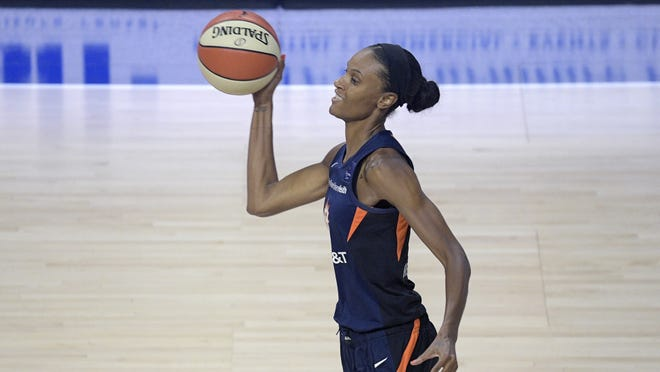 Connecticut Sun forward DeWanna Bonner passes the ball up the court during the first half of a WNBA basketball game against the Indiana Fever on Tuesday in Bradenton, Fla.