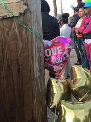 Balloons mark a memorial site for hit-and-run victim Tia Walker of Camden.