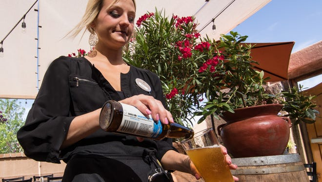 Molly Martin pours a refreshing beverage at St Clair Winery and Bistro.