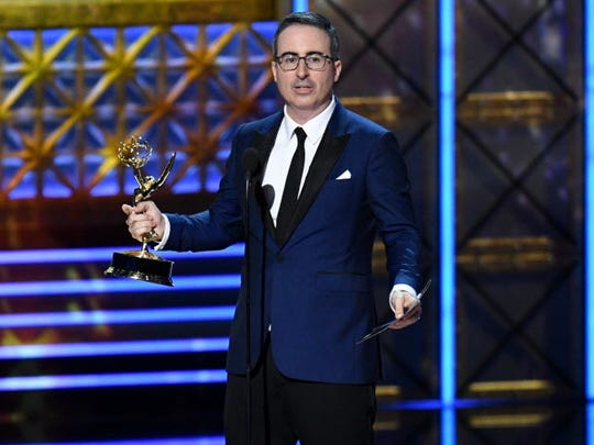 John Oliver accepts the Emmy for outstanding writing