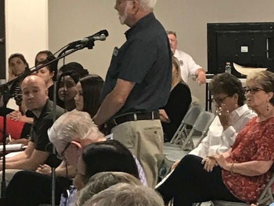 George Matula, retired environmental professional, voices concerns about the proposed plant and quarry Thursday, June 21, 2018 at the ED Civics Center in Brady.