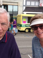 FALL FESTIVAL – There were plenty of new offerings to feast upon at this year's Fall Festival but for some, the old standards are the favorites. Urban Wolf enjoyed a bowl of burgoo from St. Phillips and his daughter, Jane Medlin savored the chicken and dumplings from Resurrection.