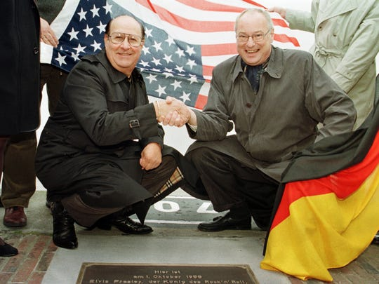 In this Oct. 1, 1998 file photo, Elvis Presley's former road manager and friend Joe Esposito, left, shakes hands with Bremerhaven mayor Manfred Richter at the point Elvis stepped on German soil.