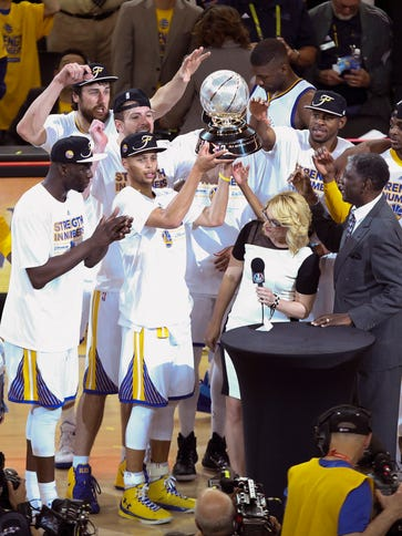 Golden State Warriors players celebrate the western