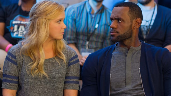 Amy Schumer and LeBron James bond over Bill Hader in 'Trainwreck.'