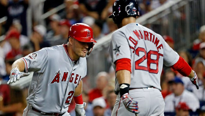 Jul 17, 2018; Washington, DC, USA; American League outfielder Mike Trout of the Los Angeles Angels (27) celebrates with American League designated hitter J.D. Martinez of the Boston Red Sox (28) after hitting a home run during the third inning in the 2018 MLB All Star Game at Nationals Ballpark. Mandatory Credit: Geoff Burke-USA TODAY Sports