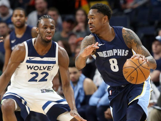 The Grizzlies' MarShon Brooks, right, drives around