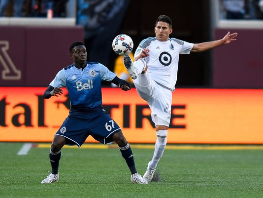 Minnesota United defender Kevin Venegas, right, and Vancouver Whitecaps forward Alphonso Davies (67) compete for the ball during the second half of an MLS soccer match Saturday, June 24, 2017, in Minneapolis. (Aaron Lavinsky/Star Tribune via AP)