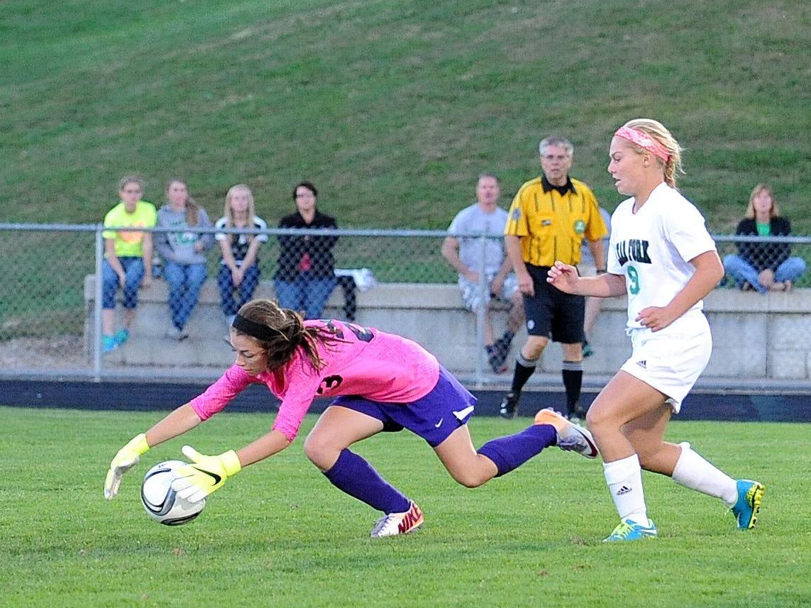 Lexington goalkeeper Rachel Cline stops an attempt on goal Tuesday evening during their game against Clear Fork.