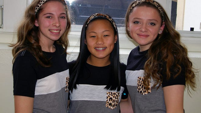 Freshmen (from left) Morgan Hagerty, Grace Bernard and Jordan Ruberti wear matching leopard print outfits for Twin Day at Our Lady of Mercy Academy.