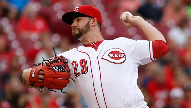 Cincinnati Reds starting pitcher Brandon Finnegan throws against the Pittsburgh Pirates during the first inning at Great American Ball Park.
