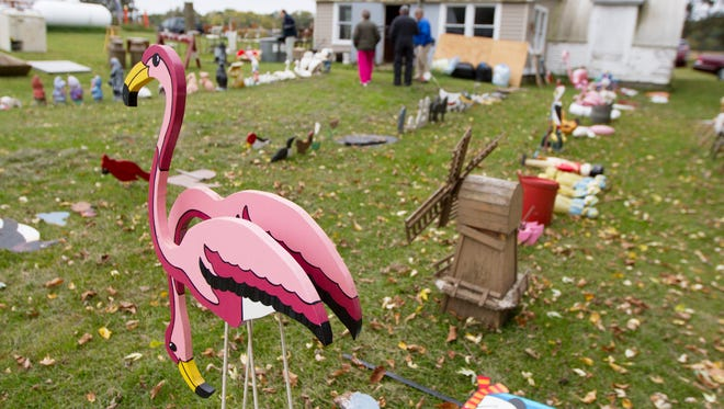Pink flamingos are among a wide assortment of lawn ornaments lined up for auction at Mayer's family farm located southeast of Eau Claire. Mayer, 82, is in the process of selling the property and moving to Eau Claire. He will miss the farm where he and six of his seven siblings were born and where he's lived his entire life, the Leader-Telegram reported.