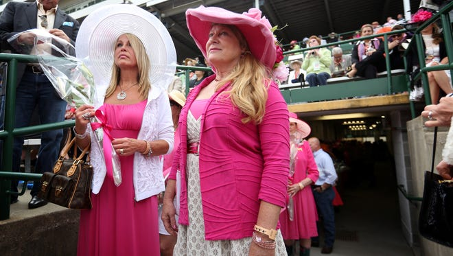 Cancer survivor Karen Terwiske, left, who was diagnosed 16 years ago, and caregiver Diane Kempf line up to walk in the Kentucky Oaks Survivors Parade at Churchill Downs ahead of the race in Louisville. May 2, 2014.