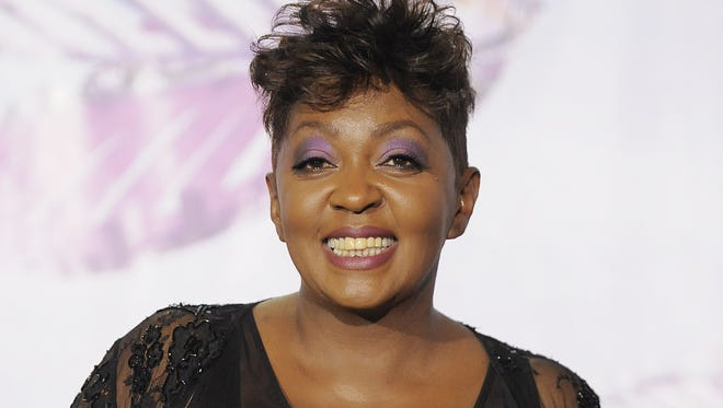 This June 26, 2011 file photo shows singer Anita Baker backstage at the BET Awards in Los Angeles.