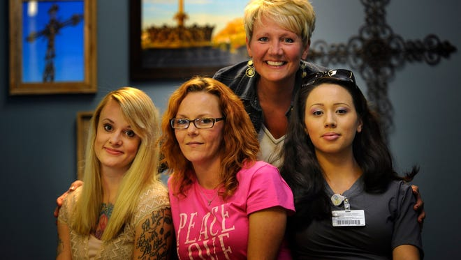 Katherine Holland, Mary Harvel and Lisa Ciamboli were working as strippers before Erin Stevens of Friendship Community Church ministered to them.