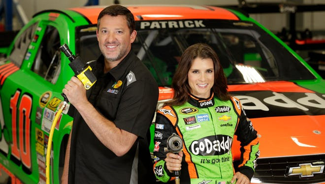 Danica Patrick and Tony Stewart aparticipate in GoDaddy's commercial at Stewart Hass Racing.
