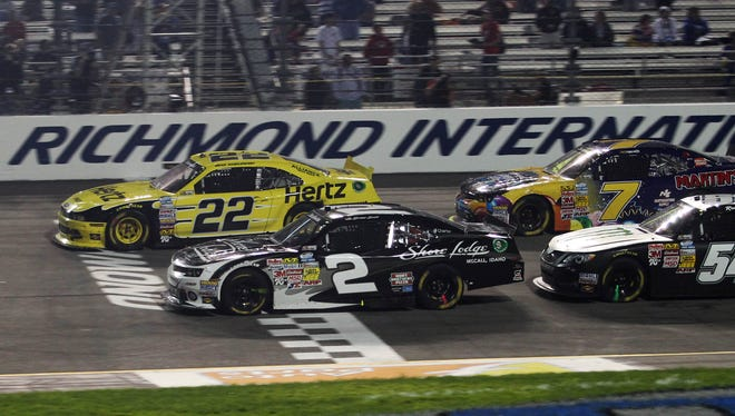 Brad Keselowski (22) leads Brain Scott (2) on a restart during the Nationwide Series race at Richmond International Raceway.