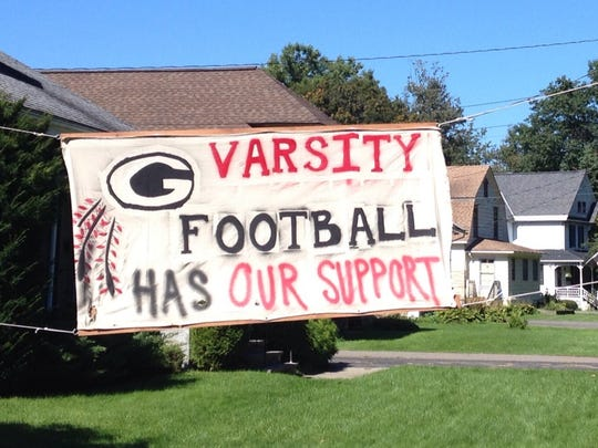 A banner supporting the varsity football team is displayed