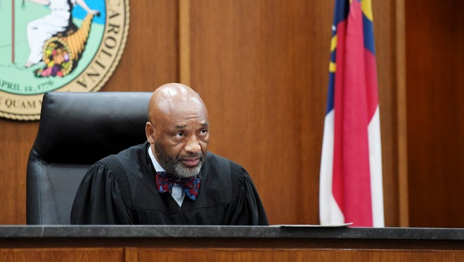 Chief District Court Judge Calvin Hill, a Candler resident and Democrat, presides over court in 2017. A proposal being considered in the state General Assembly could make it more difficult for him to stay on the bench when his current term expires.