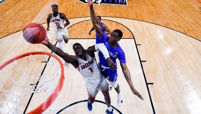Arizona Wildcats guard Rawle Alkins (1) shoots as Buffalo Bulls guard Davonta Jordan (4) guards in the game during the first round of the 2018 NCAA Tournament at Taco Bell Arena.