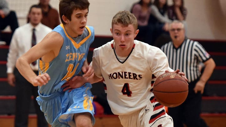 Sevastopol's Jared Pflieger drives to the basket and