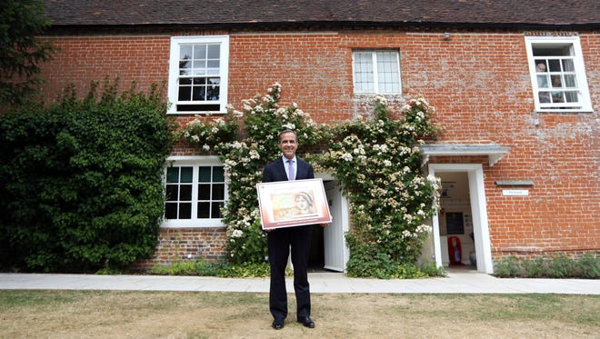 The Bank of England governor with design for ten-pound note featuring Jane Austen at the Jane Austen's House Museum, which is trying to block export of the Austen ring bought by Kelly Clarkson.