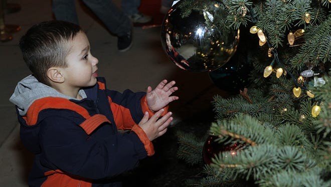 A child looks at an ornament on the town's holiday tree during the 2011 Hammonton tree lighting.