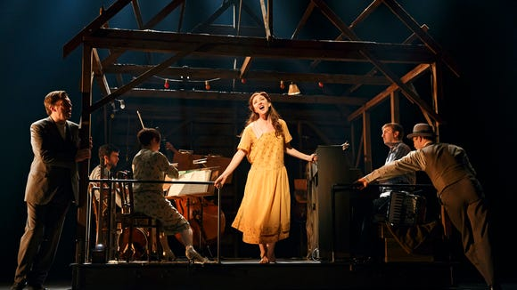 (foreground) Carmen Cusack as Alice Murphy with (from left) Scott Wakefield and Joe Jung and the orchestra of the world premiere of Bright Star, a new American musical with music by Steve Martin and Edie Brickell, lyrics by Brickell, book by Martin, based on an original story by Martin and Brickell, and directed by Tony Award winner Walter Bobbie, Sept. 14 - Nov. 2, 2014 at The Old Globe. Photo by Joan Marcus.