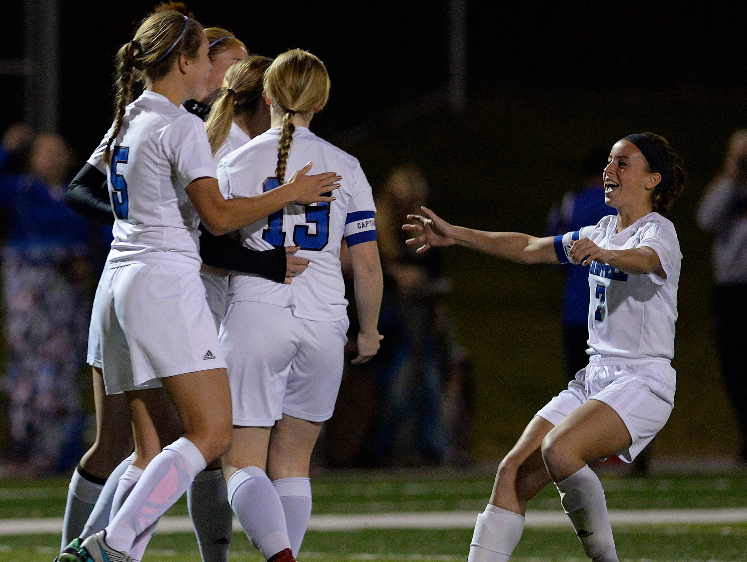 Sartell players celebrate their first goal from Tessa Hager (4) in the first half of their Sect. 8A championship game against St. Cloud Apollo Thursday, Oct. 22 at Husky Stadium.